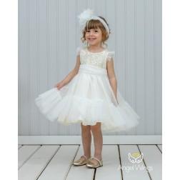 Το φόρεμα Kathy προτείνεται με το λαδόπανο της εταιρείας Lina Baby κωδικού LUX 1488